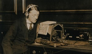 Photograph of a blind man reading a book using the Optophone c.1921.